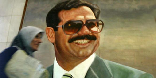 Peinture murale de Saddam Hussein, instigateur du système de corruption.