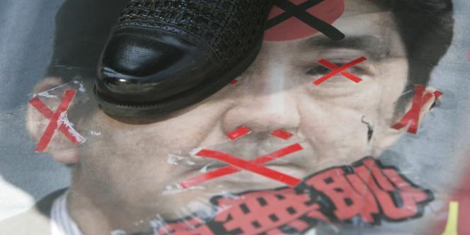 En juin 2007, des manifestants sud-coréens dénonçaient les positions du ministre japonais Shinzo Abe sur les