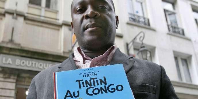 Mbutu Mondondo a déposé une plainte devant un juge d'instruction bruxellois pour racisme contre la société Moulinsart SA, qui gère les droits d'Hergé, créateur de Tintin.