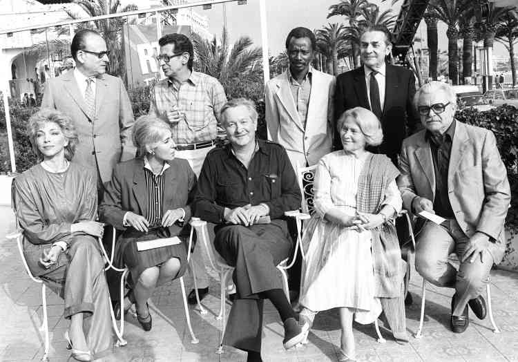 Members of the jury (front row L-R), Italian actress Mariangela Melato, journalist Yvonne Baby, US writer William Styron, person in charge of cinematheque Lia Van Leer, soviet film director Serguei Bondartchouk ; (back row L-R), French producer Gilbert de Goldschmidt, Egyptian film director Youssef Chahine, Malian producer Souleymane Cisse, and French photo director Henri Alekan, pose 06 May 1983 during the Cannes International Film Festival.