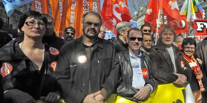 Les leaders syndicaux, en tête d'une manifestation parisienne, le 19 mars.
