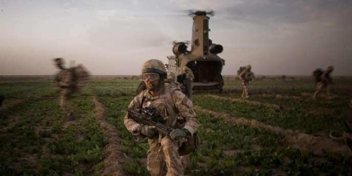 Cinq soldats britanniques de l'unité d'élite des Royal Marines ont été inculpés de meurtre pour un incident survenu en Afghanistan en 2011.