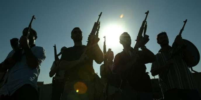 Des employés de Blackwater posent sur un toit de Bagdad, en 2007.