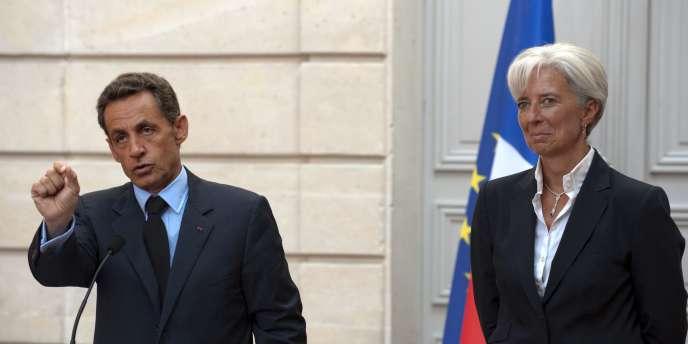 Nicolas Sarkozy et Christine Lagarde à l'Elysée, le 25 août 2009.