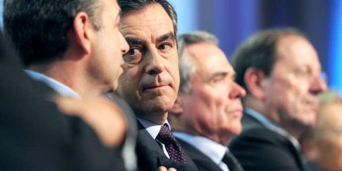 Jean-François Copé et François Fillon lors d'une réunion de l'UMP à Paris, samedi 30 janvier 2010.