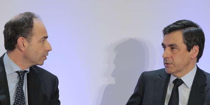 Jean-François Copé et François Fillon lors d'une réunion des parlementaires UMP, à Paris, le 29 mars 2010.
