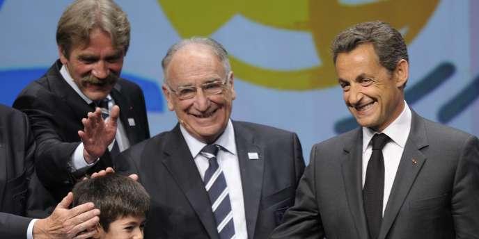 Jean-Pierre Escalettes, encadré de Frédéric Thiriez et Nicolas Sarkozy, le 28 mai.