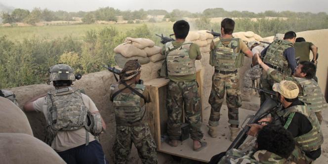 Des soldats américains et afghans, au nord de Kandahar, en juillet 2010.