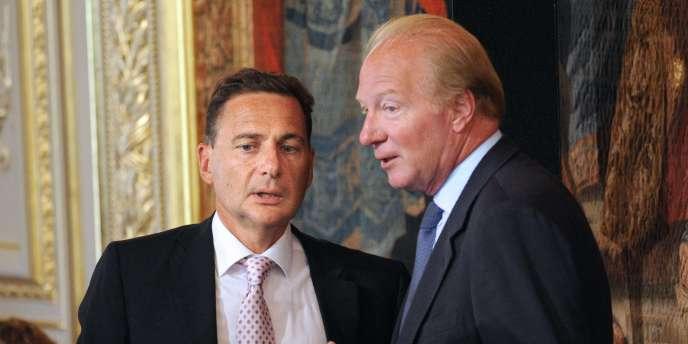 Eric Besson, ancien ministre de l'immigration, et Brice Hortefeux, ministre de l'intérieur, le 25 août à Paris.
