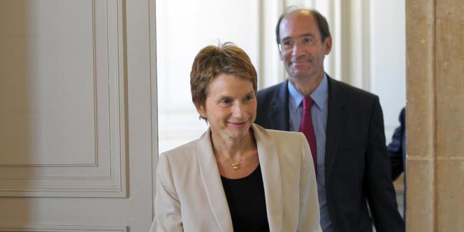 Laurence Parisot et le ministre du travail Eric Woerth, le 31 août 2010 à Paris.