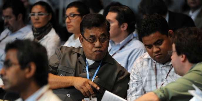 Des délégués des îles Marshall à Cancun, vendredi 10 décembre.
