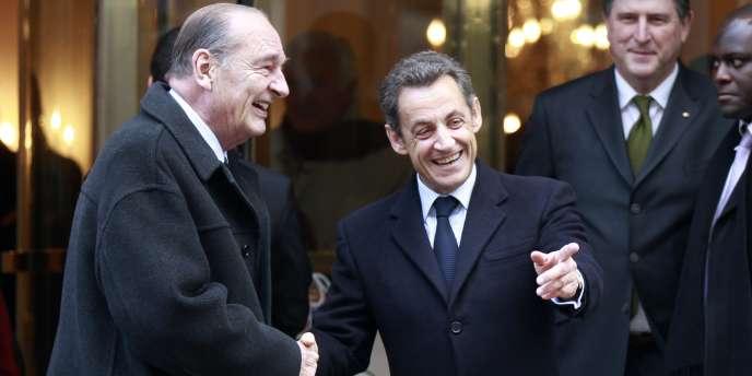 Jacques Chirac et Nicolas Sarkozy, le 21 janvier 2011, à Paris.