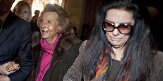 Liliane Bettencourt et Françoise Bettencourt-Meyers à la sortie du défilé Armani, le 24 janvier 2011.