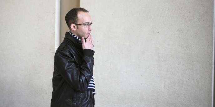 Bruno Wiel quitte la salle d'audience du Tribunal de Créteil, le 28 janvier 2011.