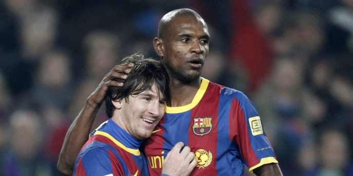 Eric Abidal avec Lionel Messi le 5 février lors de Barcelone-Atletico Madrid.