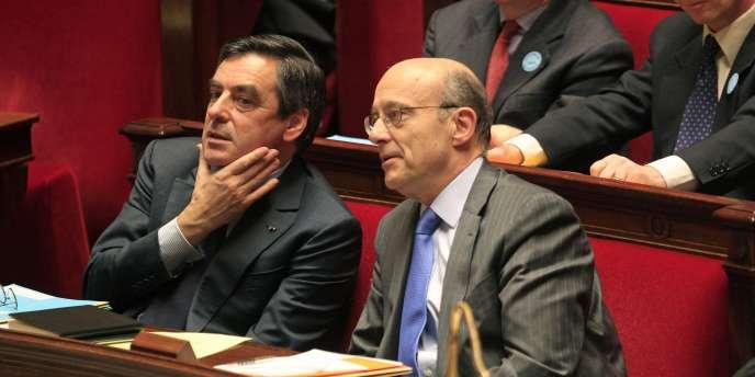 François Fillon et Alain Juppé (ici à l'Assemblée nationale à Paris, le 22 mars 2011).