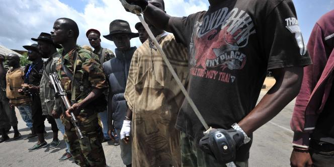Des partisans d'Alassane Ouattara, le 24 mars 2011, à Abidjan.