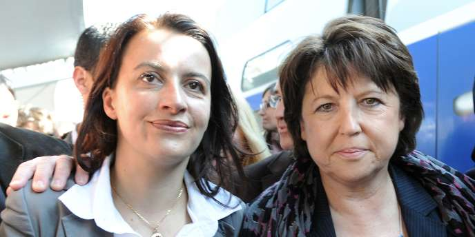 Cécile Duflot, alors secrétaire nationale d'Europe Ecologie-Les Verts, et Martine Aubry, à l'époque première secrétaire du Parti socialiste, le 23 mars, au Mans.
