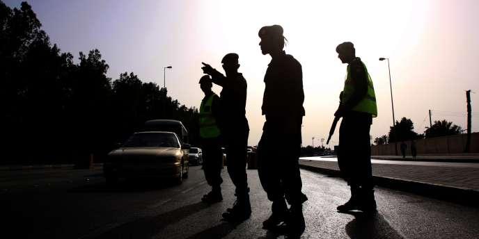 Des policiers dans les rues de Manama, le 28 mars 2011.