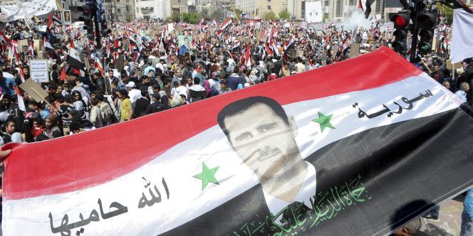 Manifestation des partisans du président syrien Bachar Al-Assad à Damas, le 29 mars 2011.