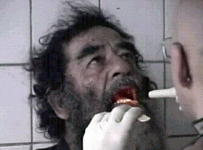 Saddam Hussein is filmed after his capture in this footage released December 14, 2003.