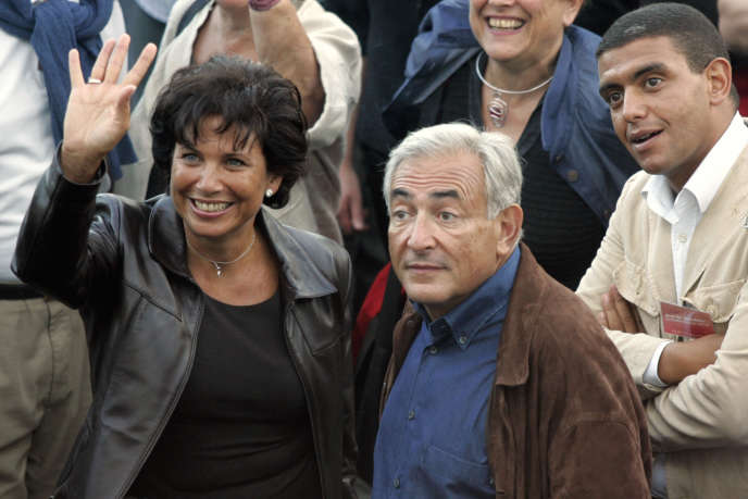 Dominique Strauss-Kahn, son épouse Anne Sinclair et Ramzi Khiroun, à la Rochelle, le 28 août 2004.