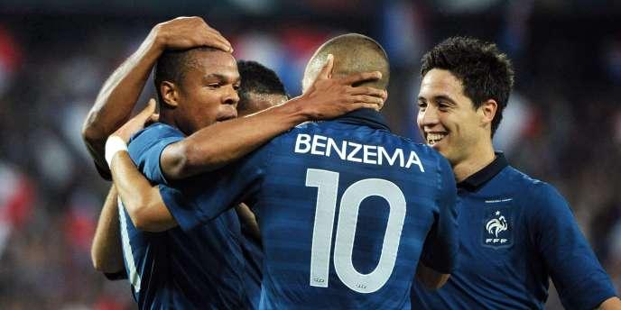 Rémy et Benzema se congratulent après le but du Marseillais, mercredi à Montpellier.