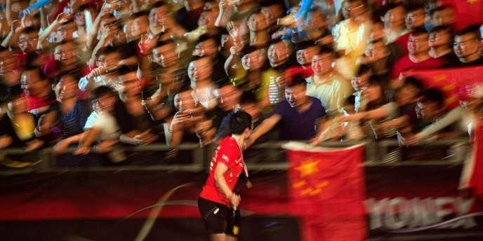 Lin Dan est champion du monde 2011 de badminton.