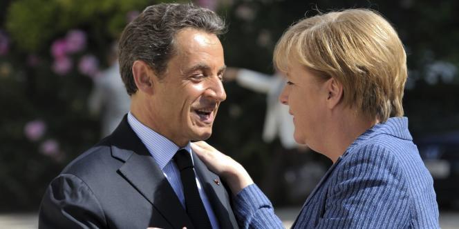 Nicolas Sarkozy accueille la chancelière allemande, Angela Merkel, à l'Elysée, mardi 16 août.