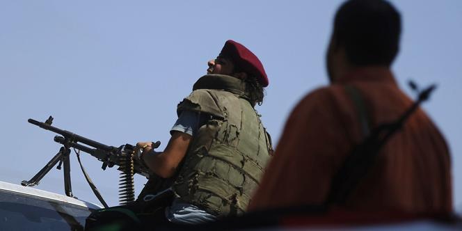 Des rebelles, dans la forêt de Gadayem, à l'ouest de Tripoli, le 21 août.