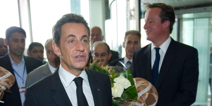 Nicolas Sarkozy et David Cameron lors de leur visite à Tripoli, jeudi 15 septembre.