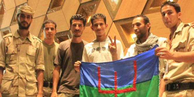 Des combattants berbères à l'hôtel Rixos, à Tripoli, le 26 septembre.