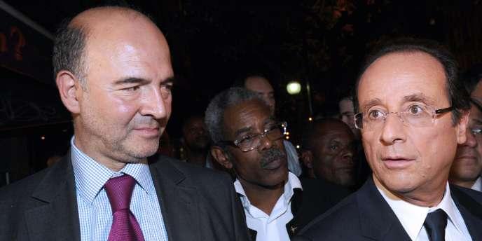Pierre Moscovici et François Hollande, le 28 septembre, à Paris.