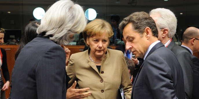 Christine Lagarde, Nicolas Sarkozy et Angela Merkel en mars 2009.