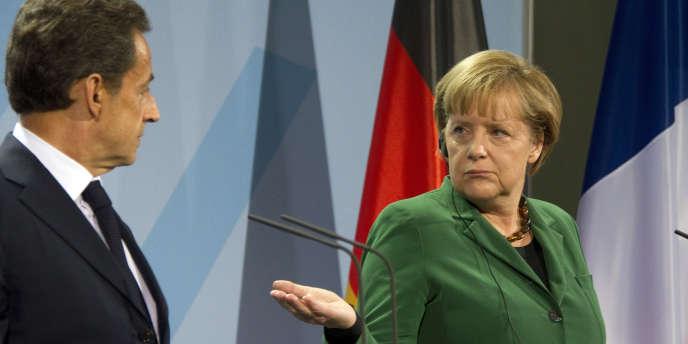 Angela Merkel et Nicolas Sarkozy, dimanche 9 octobre, à Berlin.