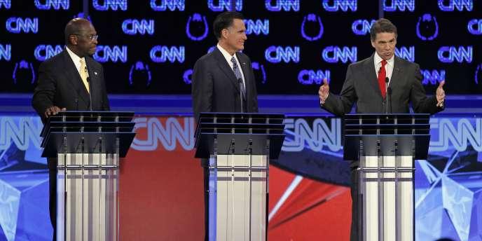 Herman Cain (à gauche), candidat républicain apprécié des Américains, a été la cible de ses concurrents Mitt Romney et Rick Perry.
