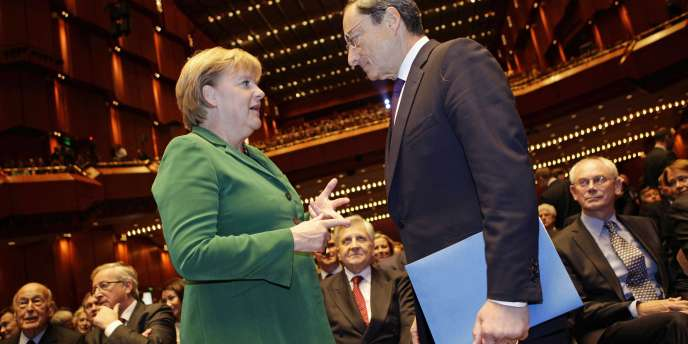 Angela  Merkel et Mario Draghi. Berlin doit gérer l'ire de la Bundesbank, dont le président Jens Weidmann a été, sans surprise, le seul des vingt-trois membres du conseil de la BCE à voter contre le nouveau programme jeudi.