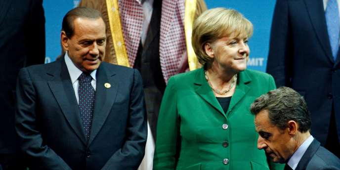 La chancelière allemande Angela Merkel, le président français Nicolas Sarkozy et le chef du gouvernement italien Silvio Berlusconi.