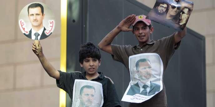 Des partisans du président syrien Bachar Al-Assad à Beyrouth (Liban).