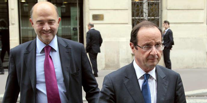 Pierre Moscovici et François Hollande, à Paris, en octobre 2011.