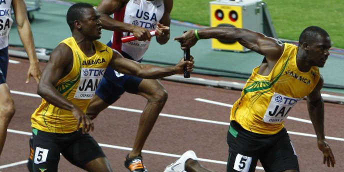 Steve Mullings, ici à gauche, est champion du monde du 4 x 100 en 2009.