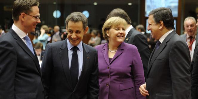 De gauche à droite, lors du sommet européen du 9 décembre à Bruxelles : Jyrki Katainen (le premier ministre finlandais), Nicolas Sarkozy, Angela Merkel et José Manuel Barroso.