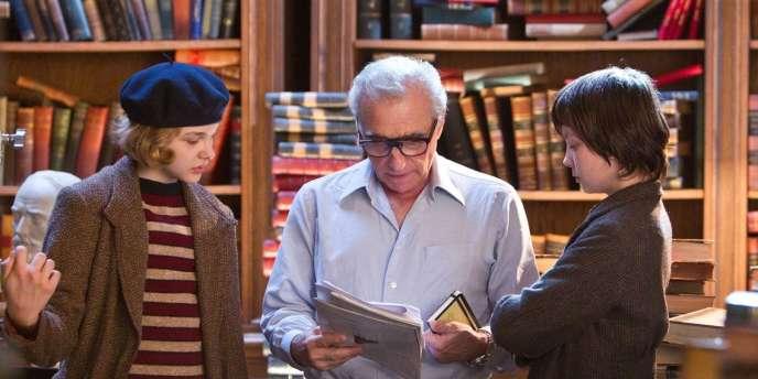 Martin Scorsese avec Chloe Moretz (à gauche) et Asa Butterfield (à droite) sur le tournage de son film