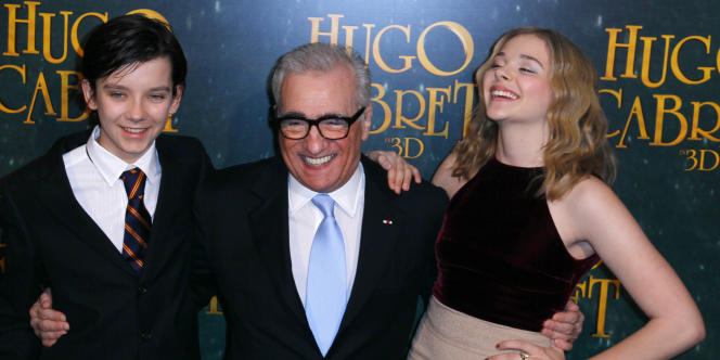 Le réalisateur américain Martin Scorsese entouré des acteurs Asa Butterfield (à gauche) et Chloe Moretz (à droite) lors de la première du film
