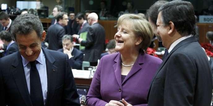 Nicolas Sarkozy, Angela Merkel et José Manuel Barroso, au sommet de l'Union européenne à Bruxelles, vendredi 9 décembre.