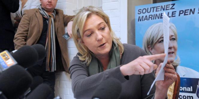 Marine Le Pen, lors d'une conférence de presse à Lille, mercredi 14 décembre.