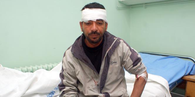 Un homme blessé lors des attentats à Damas, vendredi 23 décembre.