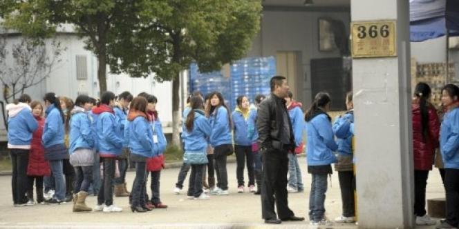 La Chine enregistre depuis quelques semaines plusieurs mouvements de mécontentement de travailleurs. Ici, un millier d'employés de la firme Hi-P International ont fait grève début décembre à Shanghaï.