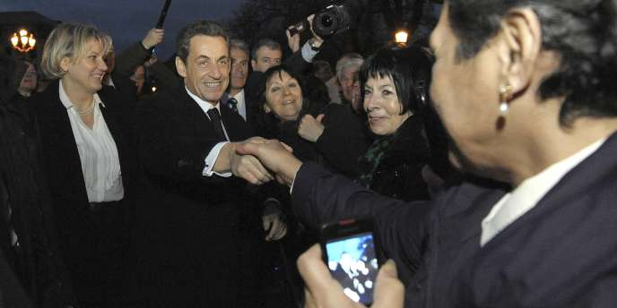 Nicolas Sarkozy arrive à la préfecture de Moselle, à Metz, le 1er janvier 2012, en compagnie de Nadine Morano.