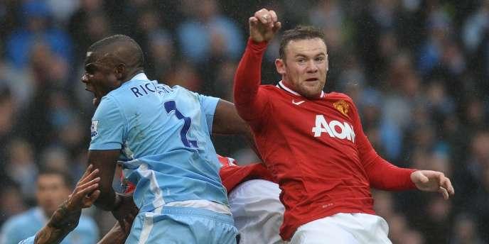 Wayne Rooney face à Micah Richards, le 8 janvier à Manchester.
